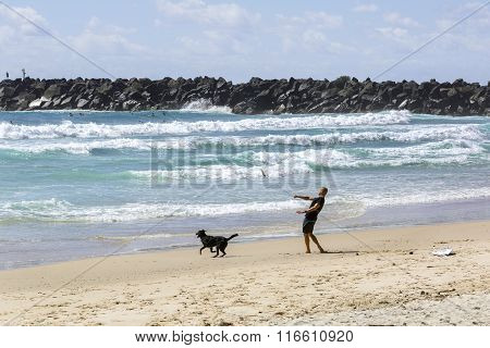 Mick Fanning playing with his dog Harper