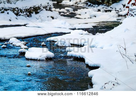 mountain river in the winter with snow