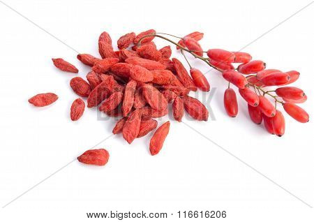 Berberries Near Goji Berries Heap Isolated On White Background