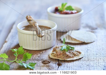 Homemade chicken liver pate with dried tomatoes and parsley