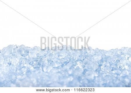 crushed ice in front of the white background .