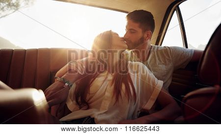 Couple On Road Trip Sharing A Romantic Kiss