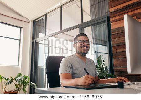 Male Graphic Designer At Work
