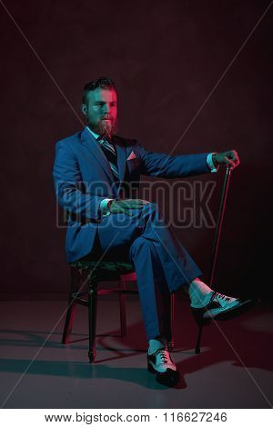 Old-fashioned Stylish Gentleman With A Cane