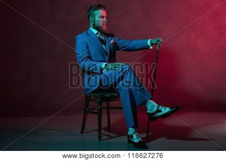 Elegant Gentleman With A Walking Stick Or Cane