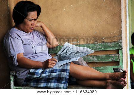 Lady reading newspaper