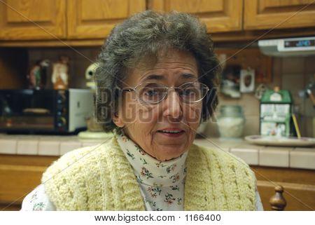 Kind Grandmother In Kitchen