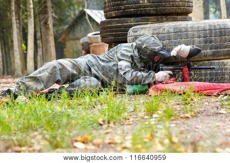 Man Lying In Ambush With Paintball Marker