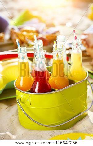 Bottles Of Lemonade Standing In Green Bucket