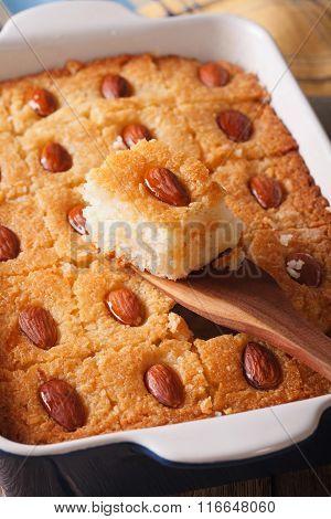 Basbousa Pie With Almonds Macro In A Baking Dish. Vertical