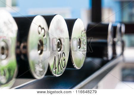 Dumb Bells Lined Up In Fitness Room