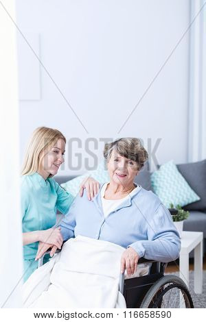 Caregiver Supporting Senior Lady