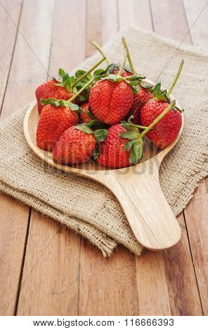 Strawberry Shrivel In Wooden Bowl