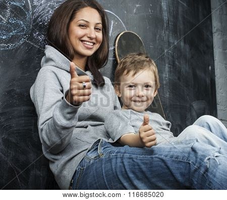 young hipster teenage girl sitting with her brother in classroom multinational