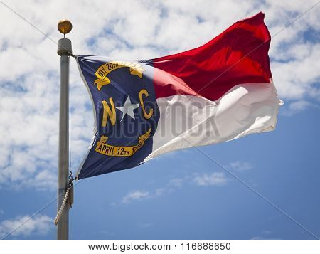 Close up view of the North Carolina flag waving in the wind in the afternoon. poster