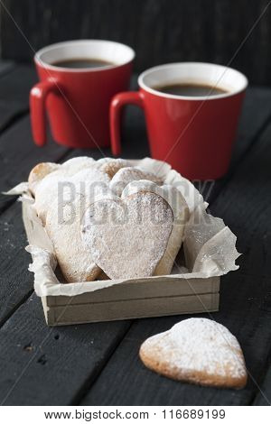 Red Cup And Cookie Hearts On A Black Background To The Valentine's Day