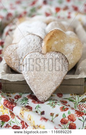 Delicious Cookies With Hearts To Valentine's Day On The Tablecloth In Red Flowers