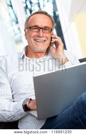 Mature Man With Laptop, Mobilephone