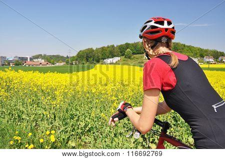 Young woman riding a mountain bike