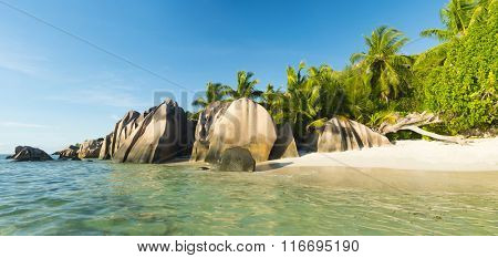 Beautifully shaped granite boulders and a perfect white sand at the famous Anse Source d'Argent beach, La Digue island, Seychelles. Panorama