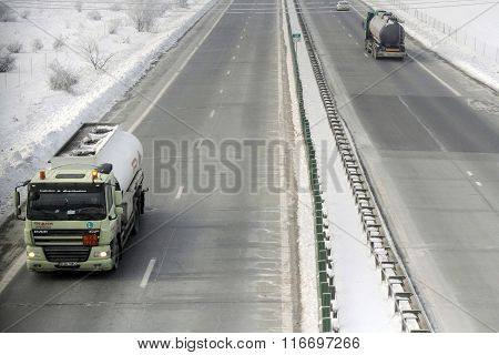 Bucharest Romania 23 January 2016: Lorries pass the high-speed A2 the main commercial route which connects Bucharest to the Black Sea's port Constantza.