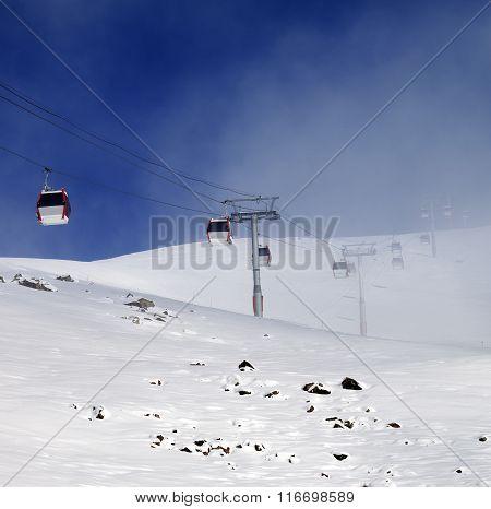 Gondola Lifts And Ski Slope In Mist
