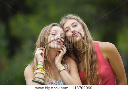 healthy young teens girls goofing about.
