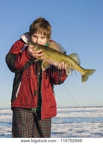 A Boy Kissing a large Walleye