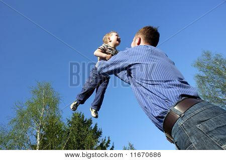 Father Toss Up A Child