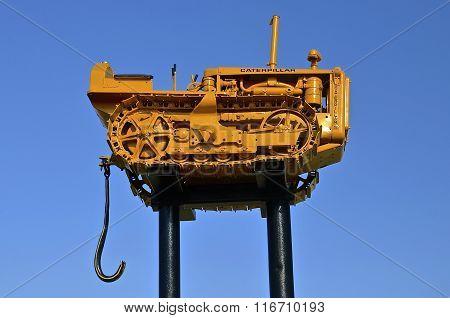 Bulldozer displayed high in the sky