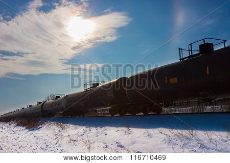 Black Tank Cars Under Blue Winter Sky
