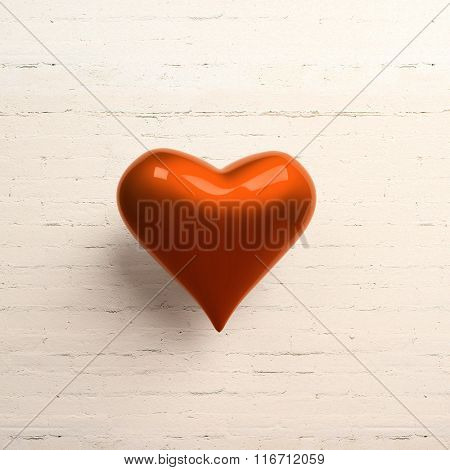 Red heart on white brick wall