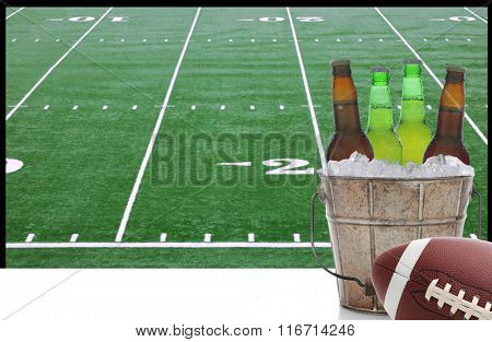 A bucket of beer and an American Football in front of a big screen television with field. Great for Super Bowl themed projects.