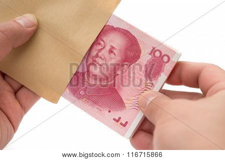 Taking Out Stack Of Rmb Paper Currency From An Envelope With Clipping Path