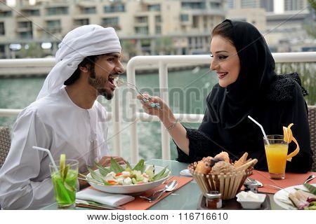 Young Emirati arab couple dining