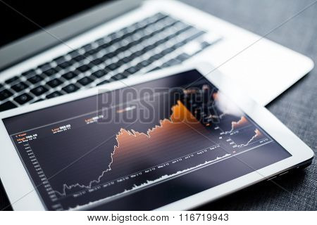 Stock market chart on tablet pc