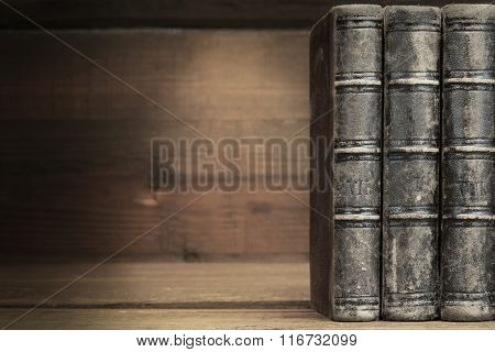 Three Old Shabby Book With Black Leather Cover Horizontal Background