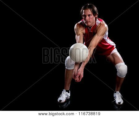 Male volleyball player. Studio shot over black.