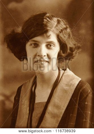 Vintage Photo: Young Woman Posing In Studio