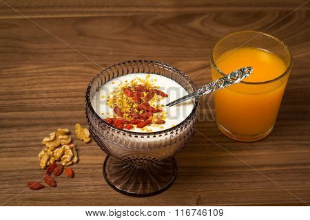 Overnight oatmeal breakfast with porridge and orange juice on white background. Focus on the spoon and porridge. poster