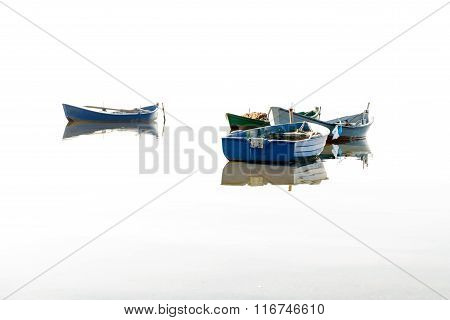 Fishing Boats Flying On The Water.
