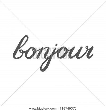 Handwritten word bonjour. Good day in French.