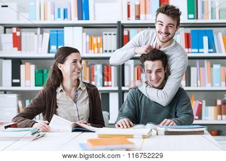 Playful Schoolmates Studying Together