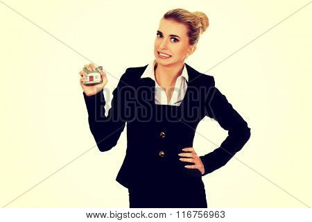 Aggresive businesswoman crushing small house