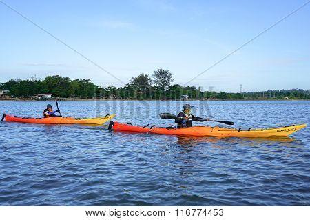 Group of adventurer enjoying sea kayak expedition activity.
