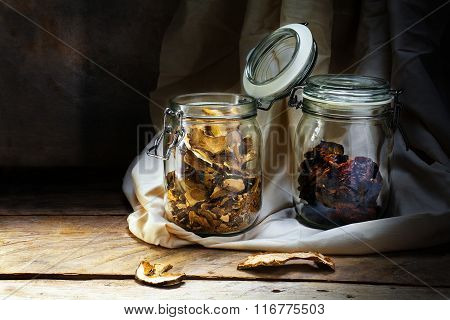 Glass Jars With Dried Food On An Old Wooden Shelf In The Rustic Storage Chamber, Countryside Still L