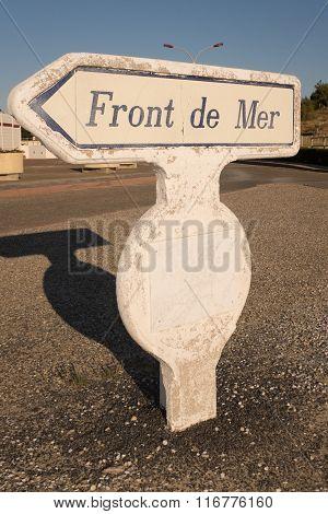 An Old Coast Path Sign On A Blue Sky