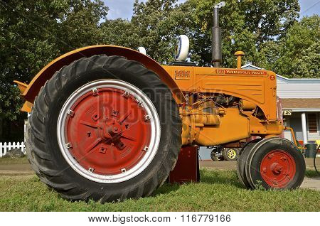 ROLLAG, MINNESOTA, September 6, 2015: The restored Minneapolis Moline tractor came from a merger of three companies, Minneapolis Steel & Machinery (MSM), Minneapolis Threshing Machine, and Moline Plow and headquartered in Hopkins, MN. poster