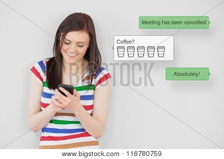 Smartphone text messaging against smiling girl using her mobile phone