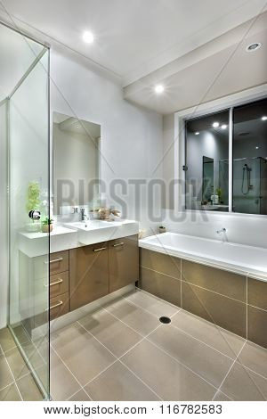Modern Bathroom With Dark Color Floor Tiles With Lights On